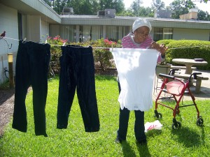 Ms Sims hanging out her laundry